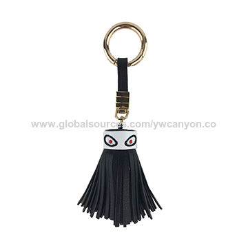 China 2016 fashion women's PU leather tassel, two big eyes with king ring for decoration