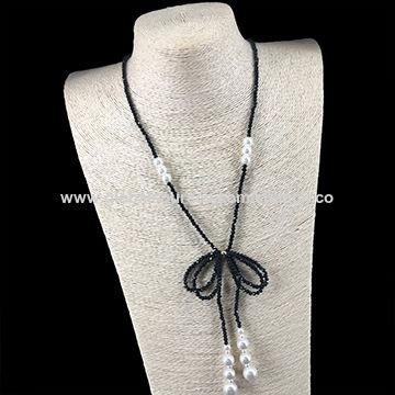 c95f2c3bf24d China Los collares elegantes con negro tallaron gotas y las perlas de  imitación