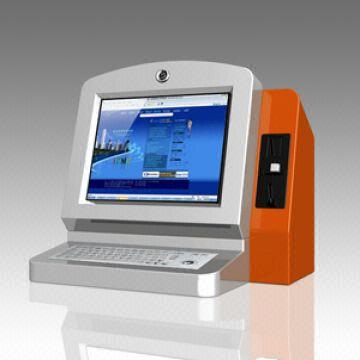 Desktop touchscreen internet kiosk with metal keyboard and coin