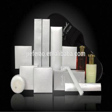 deluxe hotel amenities: 1  silver cardboard box  2  loofah