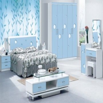 a bedroom set with 1 wardrobe, 1 bed, 2 bed tables and a dresser ...