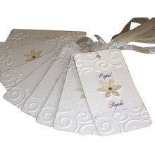 China Paper tags with ribbons, hot stamping and embossing