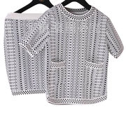 High quality knitted twin set with black and white geometric pattern, contain knit top and dress from Meimei Fashion Garment Co. Ltd