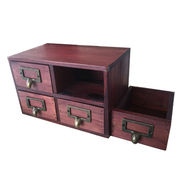 Wooden cabinet with four drawers in distressed finish