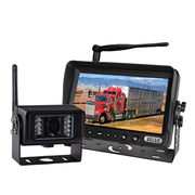 Wireless surveillance camera security system for agricultural tractor