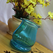 Glass mason jars in various colors with lids, suitable for decoration