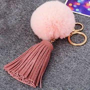 Chic pink plush pom pom keychains from  Chanch Accessories International Co. Ltd